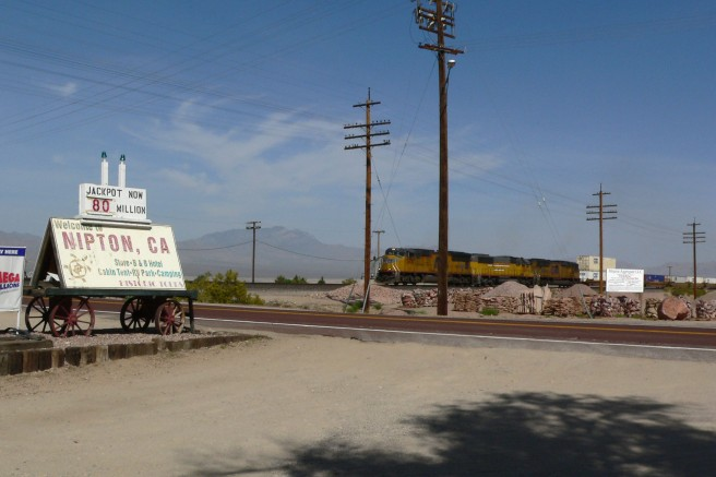 View of Nipton, California, with freight train passing through (Image source: Stan Shebs)