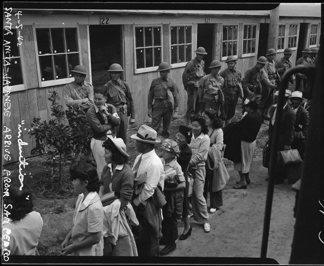 Evacuees of Japanese ancestry arriving at the Santa Anita Assembly center from San Pedro, California