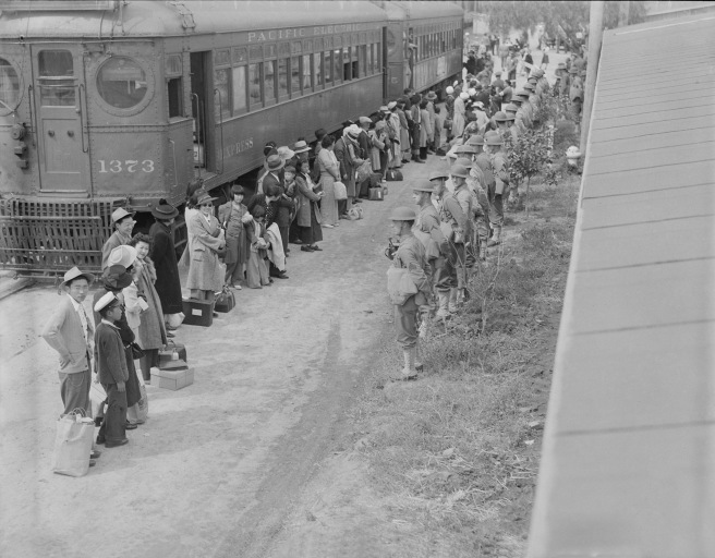 Persons of Japanese ancestry arrive at the Santa Anita Assembly center from San Pedro, California
