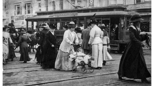 Pedestrians in downtown Los Angeles in the early 1900s with Grand Ave. trolley car in background.