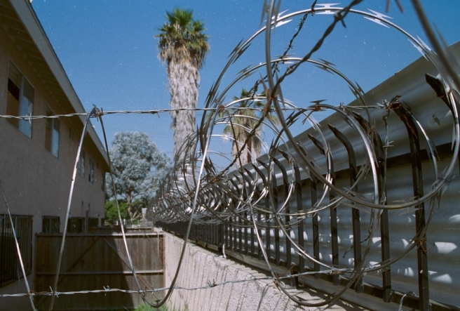 1997.0268.24.6_razor_wire_wall_bars_corrogated_panels